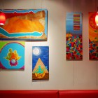 Art hangs inside of Caje for costumers to enjoy.
