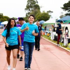Members of the San Miguel Hall team walk laps to aid in the fight against cancer