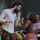 Alex Ebert and Jade Castrinos of Edward Sharpe & the Magnetic Zeros sing to each other during the band's main stage performance.
