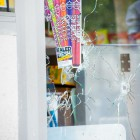 Bullet holes in the IV Deli Mart window on Pardall Road. (Photo by Lorenzo Basilio)
