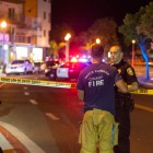 Paramedics talk at one of the nine crime scenes in Isla Vista on May 23. (Photo by Lorenzo Basilio)