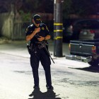 A police officer on the night of the shootings on May 23. (Photo by Mark Brocher)