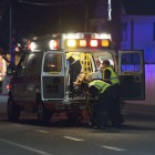 An injured victim is put into an ambulance by paramedics on May 23. (Photo by Mark Brocher)