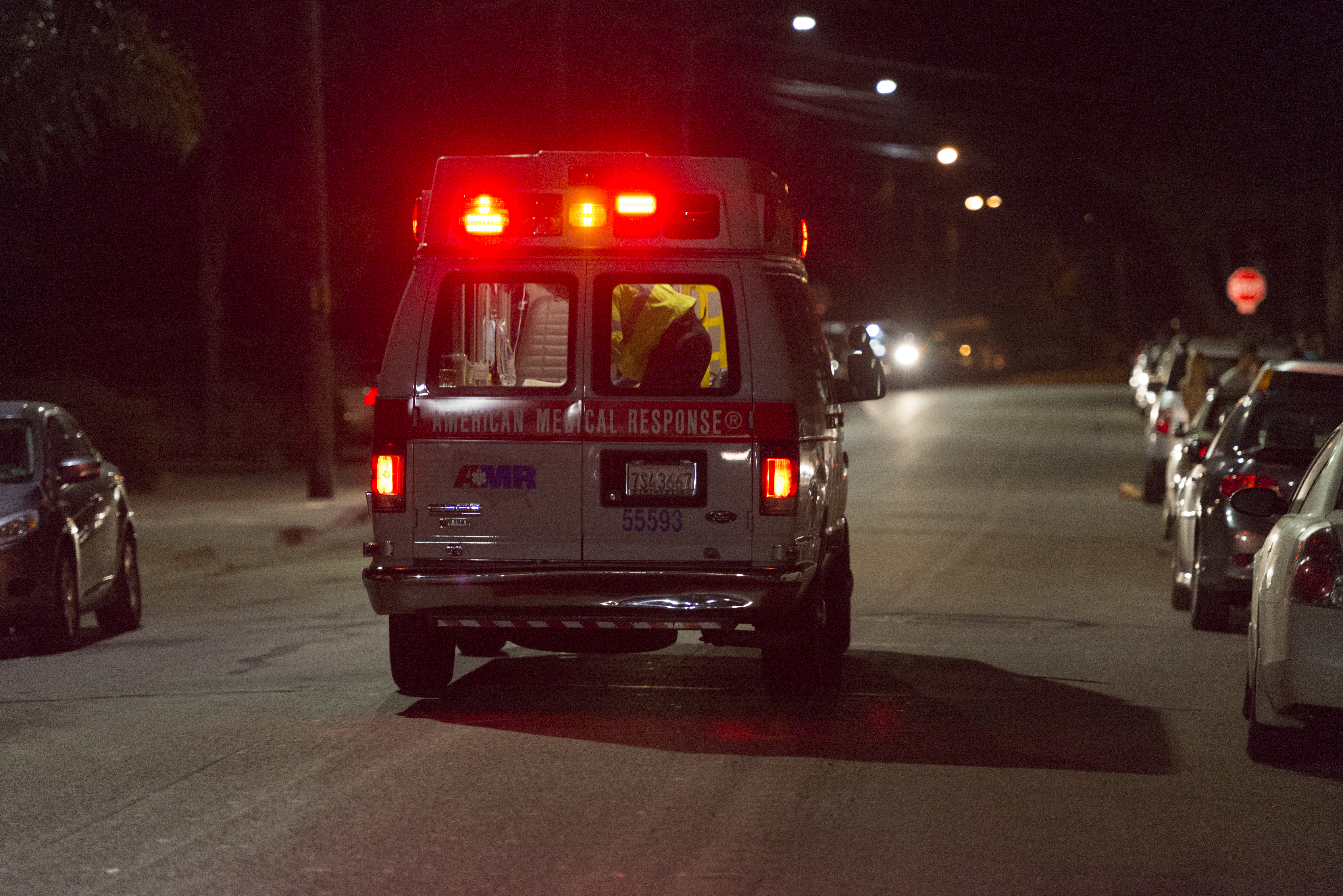 An ambulance transports an Isla Vista resident to Cottage Valley Hospital the night of the shootings. (Photo by Mark Brocher)