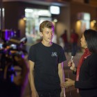 An Isla Vista resident is interviewed by a news crew the night of the shootings. (Photo by Mark Brocher)