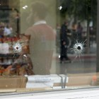 Bullet holes in the 7-Eleven window on Trigo Road. (Photo by Mark Brocher)