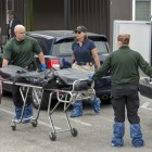A body is removed from the killer's apartment at the Capri complex on Seville Road on May 24. (Photo by Mark Brocher)