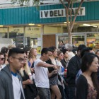 Students walk down Pardall Road in front of IV Deli Mart on their way to Anisq'Oyo Park in Isla Vista on May 24. (Photo by Mark Brocher)
