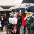 Marching with university staff and student demonstrators, External Vice President of Statewide Affairs Mohsin Mirza (center) funnels through North Hall – the site of previous activism by the Black Student Union.