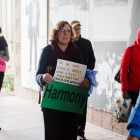 Vice Chancellor of Student Affairs Margaret Klawunn marches with demonstrators through campus. For the march, participants were given signs with the words justice, compassion, empathy, harmony, peace and love – phrases organizers believe Dr. King embodies.