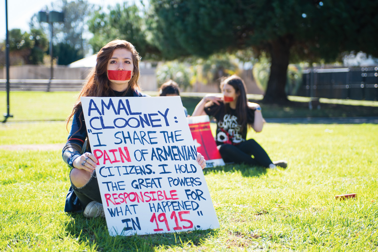 Third year philosophy major Melanie Moradi sits on the lawn in front of storke tower with a sign calling attention to the gravity of the Armenian genocide. An estimated 1.5 million Armenians are believed to have perished at the hands of the Ottomans. Mathew Burciaga/Executive Managing Editor