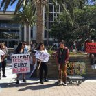 El Congreso members protest Columbus Day in front of the library. Madeleine Lee/Campus Beat Reporter